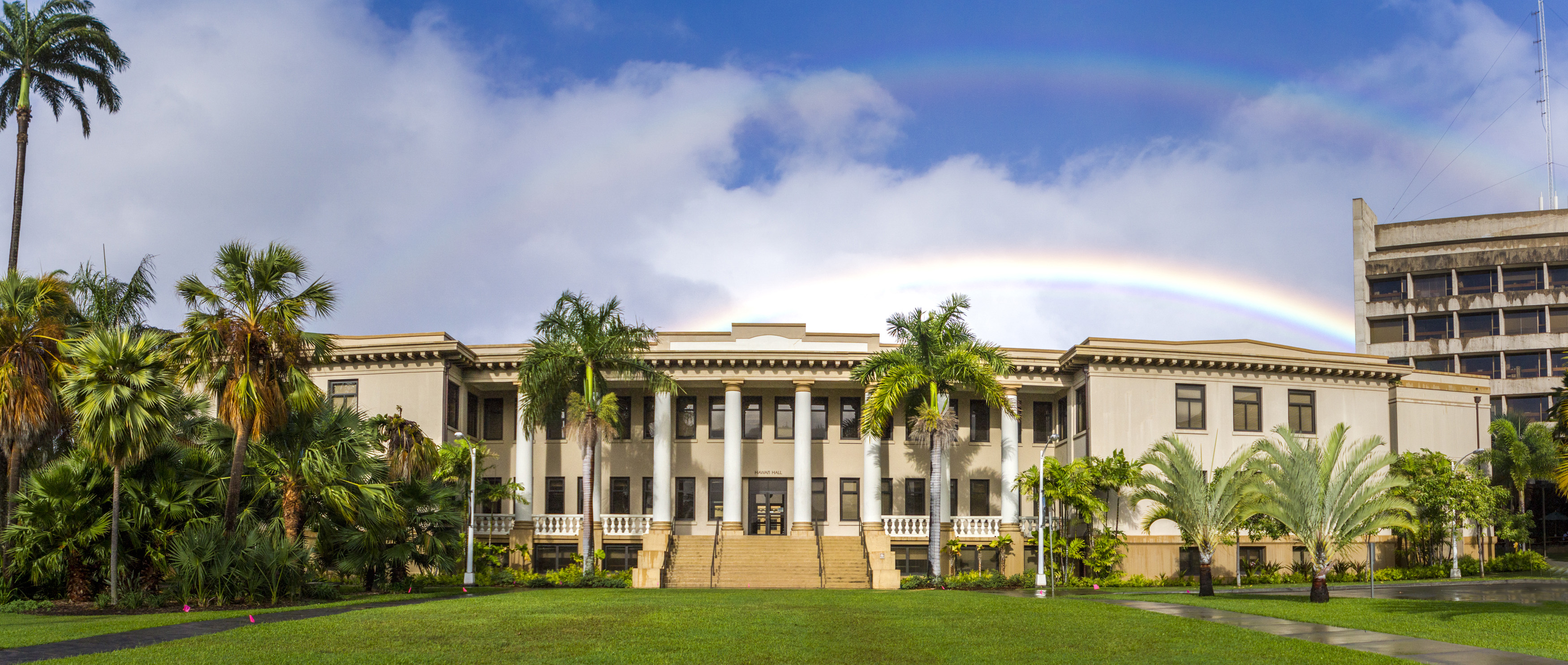 Double rainbow over Hawaii Hall and palm trees
